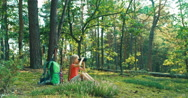 Hiker girl 8-9 years child using binoculars and looking at distance in forest Stock Footage
