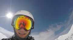 POV of a young man skier taking a selfie while on a snow covered mountain top. Stock Footage