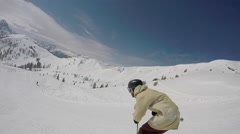 A young man freestyle skier skiing and going off jumps in a terrain park on a sn Stock Footage