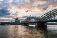 Sunset view of Cologne Cathedral and Hohenzollern Bridge Stock Photos