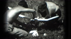 1946: shirtless teenage boys working on model airplane in summer sun. Stock Footage
