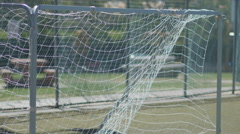 Soccer goal net blowing in the wind on a turf playing field. Stock Footage