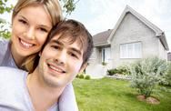 Happy couple near new house. Stock Photos
