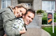Happy couple near new house. Stock Photos