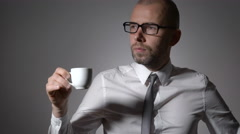 Enjoying fresh coffee. Confident young charming man in shirt and eyeglasses Stock Footage
