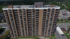 Apartment Building Decending Stock Footage