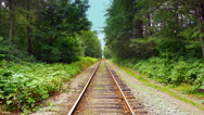 4K Rail Road Train Tracks Perspective View, Steel Railway through Forest Stock Footage
