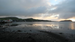 Yacht departing Campbeltown at dawn Kintyre Scotland Stock Footage