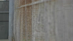 Chain link fence surrounding outdoor basketball court. Stock Footage