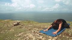 Woman stretching in yoga lotus pose, padmasana Stock Footage