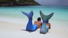 Mermaid couple relaxing on a tropical beach Stock Footage