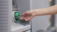 Hand with credit card, using a ATM in slow motion Stock Footage
