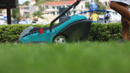 Man cutting lawn with grass mower Stock Footage