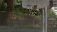 A young man basketball player missing dunk on an old outdoor basketball hoop. Stock Footage