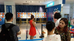 Young woman practicing archery Stock Footage
