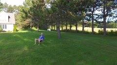 Old man sitting on chair on lawn Stock Footage