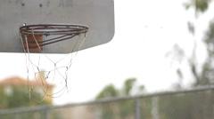 A rusted urban outdoor basketball hoop. Stock Footage