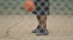 A young man basketball player practicing his ball handling. Stock Footage