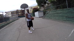 POV of two young men playing basketball together. Stock Footage