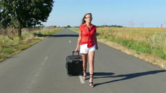 4K. Adult sexy woman with long legs  with  suitcase on  road. Summer time Stock Footage