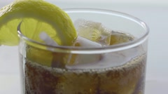Macro pouring soda with straw and lemon Stock Footage