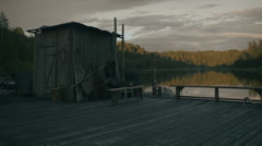 Wooden vintage jetty on lake at sunset Stock Footage