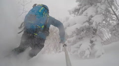 POV of young man skier skiing on a mountain during snow storm. Stock Footage