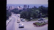 1963: palm tree lined streets of wealthy part of town view from hotel room Stock Footage