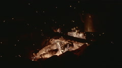 Vintage kettle over burning wood in the fire in the slow motion Stock Footage