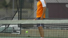 Male tennis player bouncing tennis ball with racket. Stock Footage