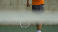 Male tennis player serving during match. Stock Footage