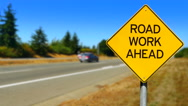 4K Road Work Ahead, Yellow Diamond Sign, Seamless Looping Stock Footage
