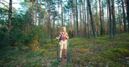 Little hiker girl child walking in forest at camera Stock Footage