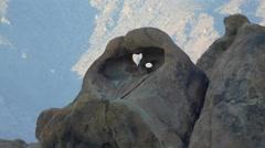 Heart shape in boulder rock formation in mountainous desert. Stock Footage