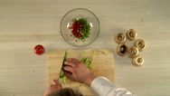 First person view to prepare stuffing mushrooms Stock Footage