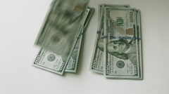 Splitting Money Into Two Equal Stacks Stock Footage