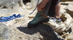 Detail of a man putting on his rock climbing shoes. Stock Footage