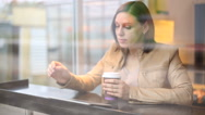 Woman in cafe with tablet (Focus on the tablet) Stock Footage