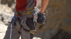 A rock climber putting chalk on his hands for better grip. Stock Footage