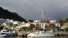 Catamaran Moored in Puerto De Mogan Stock Footage