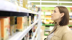 Woman checking food labelling in supermarket Stock Footage