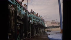 1963: large group of men fishing together at the pier  Stock Footage