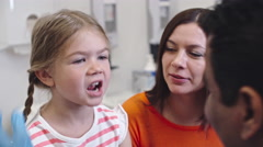 : Doctor Checking Sore Throat of Little Girl Stock Footage