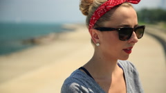 Portrait of a young woman with sunglasses and a red bandana. Stock Footage