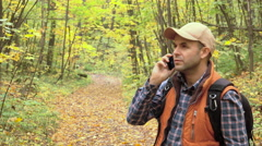 Young Man With talking on the phone Looking For Direction On The Forest. Cauc Stock Footage