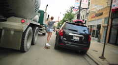 A young woman goes longboard skateboarding. Stock Footage