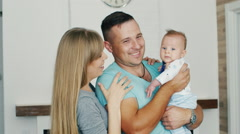 Happy family with a baby at home. Strong family, a happy childhood Stock Footage