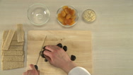 Prunes cutting for a cake. Stock Footage