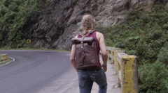 Travel and Adventure - Hitch Hiker on Highway in South America Stock Footage