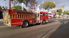 Fire truck rushing through Santa Monica Blvd in West Hollywood 4K UHD Stock Footage